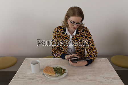 female executive using digital tablet in