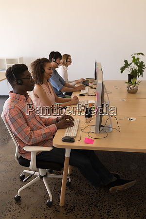 executives working on personal computer while