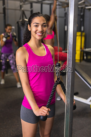 female athlete exercising with triceps pushdown