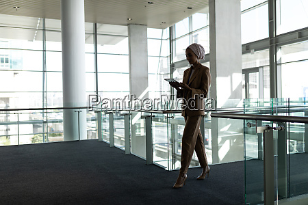 side view of businesswoman using digital