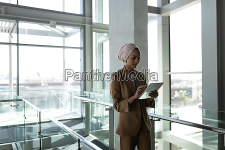 front view of businesswoman using digital