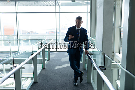 front view of businessman leaned on