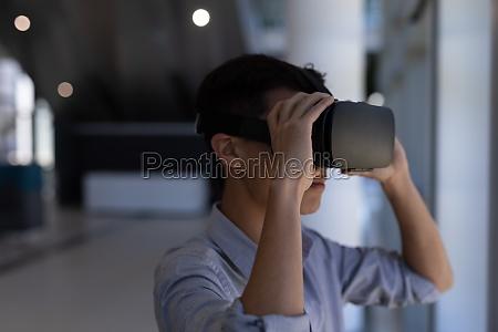 asian male executive using virtual reality