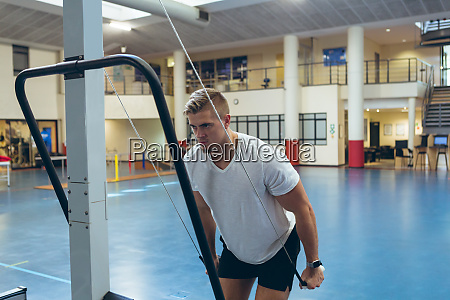 male athlete doing triceps exercise in