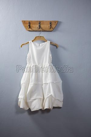 dress hanging on hook