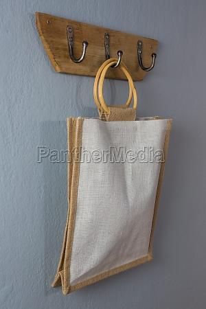 handbag hanging on hook