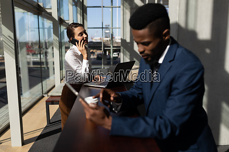 caucasian businesswoman talking on mobile phone
