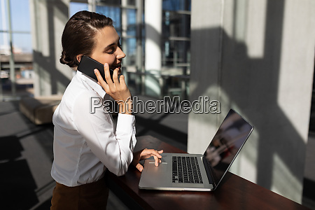 young caucasian businesswoman talking on mobile