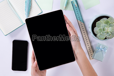 women holding a tablet in a