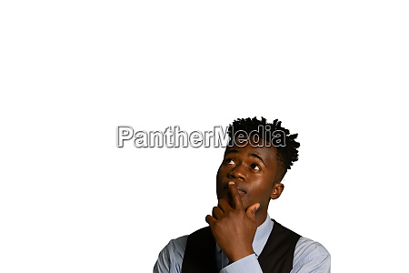puzzled businessman touching his face and