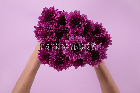 woman holding a purple bouquet of