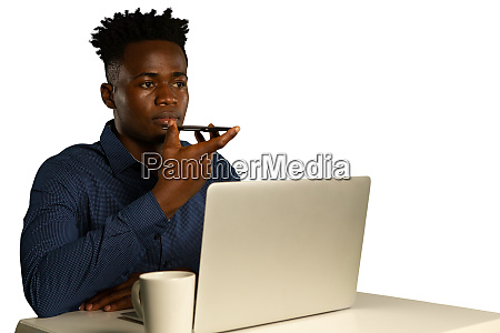 young businessman using a laptop and