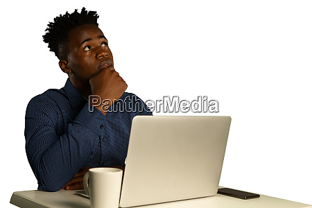 young puzzled businessman with laptop