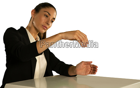 young woman sitting at desk looking