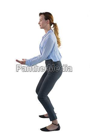 female executive pretending to hold an