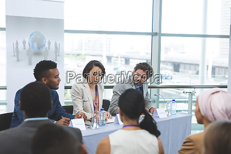 business people sitting at table in