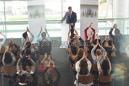 business people applauding in a business