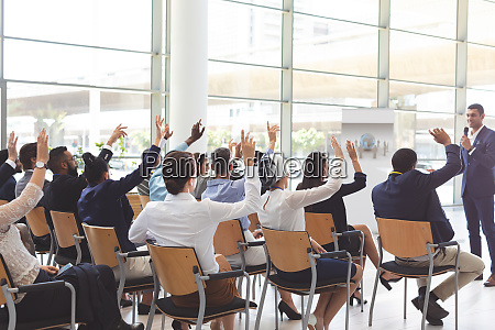 group of business people raising hands