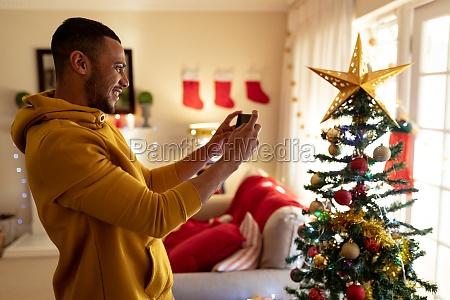 man at home at christmas time