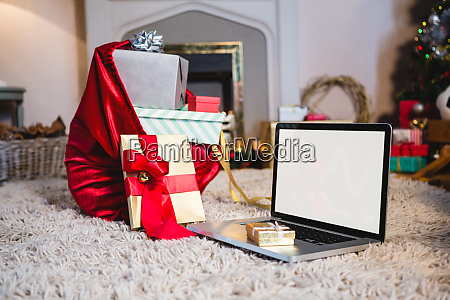 gift sack gift and laptop placed