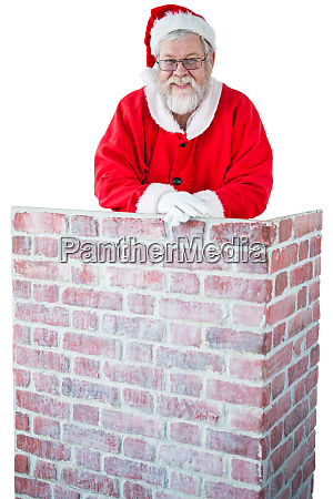 santa claus leaning on the chimney