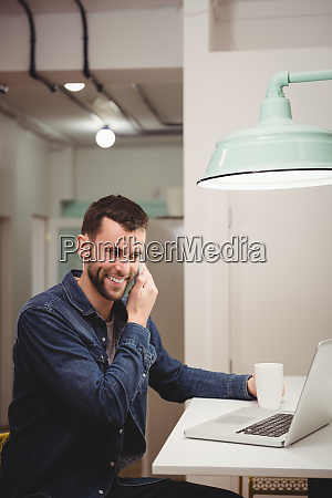 male executive talking on mobile phone