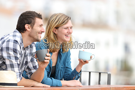 happy tourists drinking coffee and sightseeing