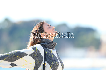 girl breathing fresh air stretching arms