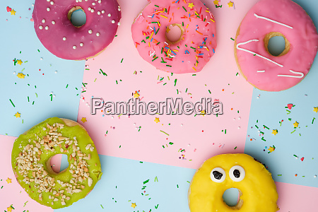 whole round pink donuts with colored