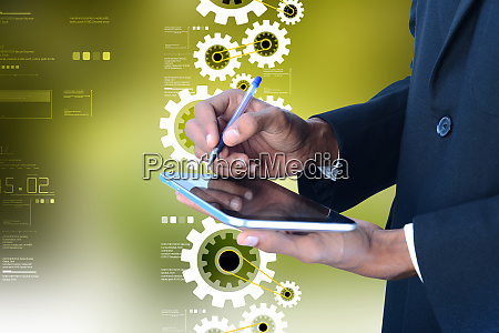 digital tablet in hand and gears