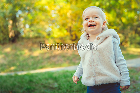 happy baby rejoices autumn weather and