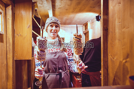 baker on the christmas market selling