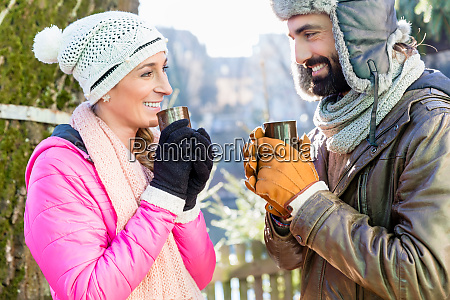 woman and man drinking mulled wine