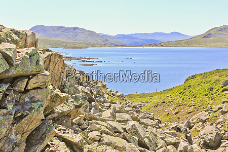 vavatn lake between rocks boulders and