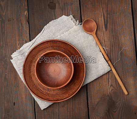 empty brown ceramic plates on a
