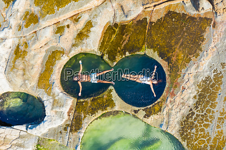 aerial view of couple floating at