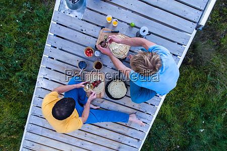 friends having breakfast in wilderness