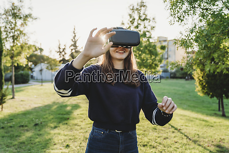 young, woman, looking, through, vr, headset - 27625478