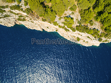 aerial view of cliff and sea
