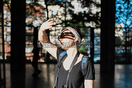 woman traveller covering eyes from sun