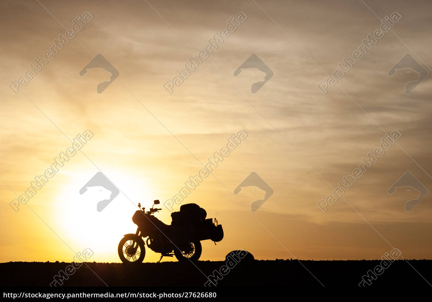 silhouetted, touring, motorcycle, at, sunset - 27626680