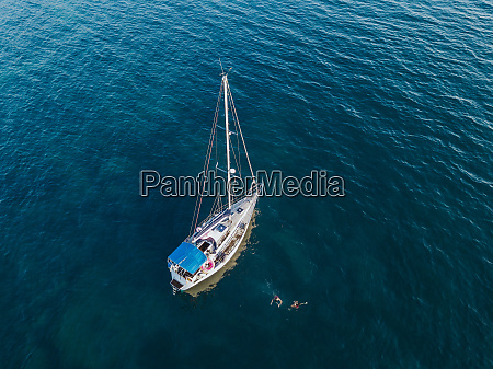 sailboat afloat on sea italy