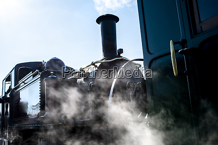 steam train emitting clouds of smoke