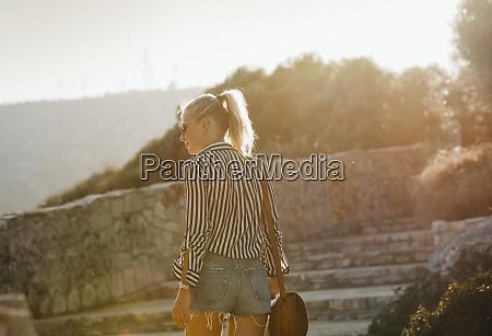 woman traveller exploring island garraf spain