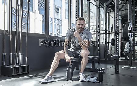 man resting at gym bangkok