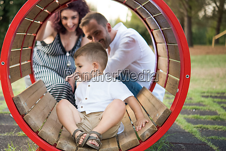parents watching son play in circular