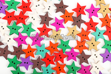 multicolor star shaped wooden buttons on