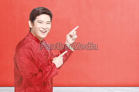 an asian chinese man in cheongsam