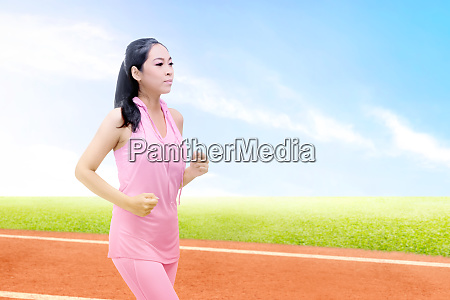 asian runner woman running on the