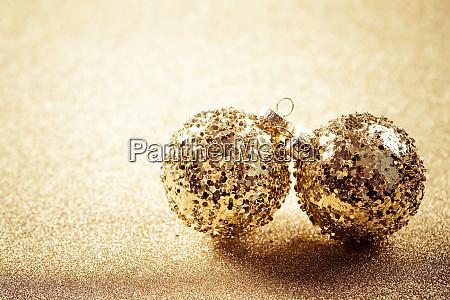 golden christmas balls on glitter background